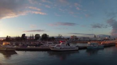 Sunset timelapse and boat silhouette at Olhão, capital of Ria Formosa wetlands natural conservation region landscape, Algarve, southern Portugal. — Stock video