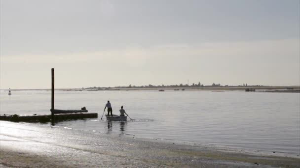 Landscape view from Olhão fishing port to Armona, one of the islands of Ria Formosa wetlands natural conservation region, Algarve, southern Portugal. — Vídeo de stock