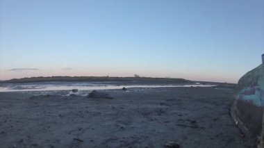 Pan time lapse, at Ria Formosa wetlands natural park landscape, view from Fuseta town to historic life guard building and also some crabs moving in foreground, Algarve. — Stock Video