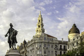 PORTO, PORTUGAL - JULY 04, 2015: Monument of King Pedro IV statue in foreground and city hall in the top of Aliados Avenue, on July 04, 2015 in Porto, Portugal. — Stock Photo