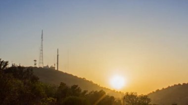 Sunset country landscape in Algarve tourism destination region, rural hillside Cerro Sao Miguel and communication antennas silhouette in background — Stock Video