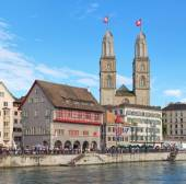 Zurich cityscape with Grossmunster decorated with flags — Stock Photo