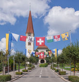 Street in Wallisellen decorated with flags for the Swiss Nationa — Stockfoto