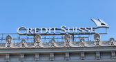 Credit Suisse logo on the top of the Credit Suisse office — Stock Photo