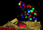 Christmas ornaments with gold box — Stock Photo