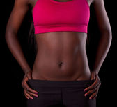 African female torso with exposed belly — Stock Photo