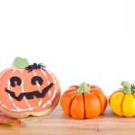 Halloween arrangement with cookie and pumpkins — Stock Photo #55423669