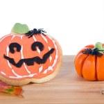 Halloween arrangement with cookie and pumpkins — Stock Photo #55423895