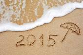 Inscription of the year 2015 written in the wet yellow beach sa — Stock Photo