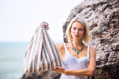 Woman posing with cotton fabric striped bag — Stock Photo