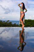 Pretty brunette model in bikini posing at the pool  — Stock Photo