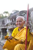 Female monk dressed in orange toga — Stock Photo