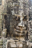 Stone face of king Jayavarman VII — Stock Photo
