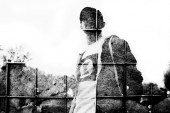 Double exposure with Man's siluette against city background — Stockfoto