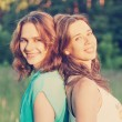 Portrait of two beautiful young women friends — Stock Photo #52444579