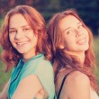Portrait of two beautiful young women friends — Stock Photo #52444709