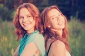 Portrait of two beautiful young women friends — Stock Photo