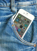 Iphone in blue jeans pocket, editorial photo — Stock Photo
