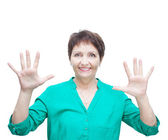 Attractive emotional woman 50 years old, isolated on white backg — Stock Photo