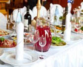Table laid for a banquet — Stock Photo
