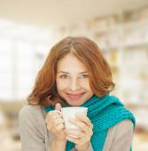 Young woman in blue scarf with white mug — Stock Photo