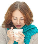 Young woman in blue scarf with white mug isolated on white backg — Stock Photo