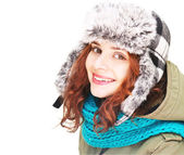 Emotional young woman in winter clothes, isolated on white background — Stock Photo