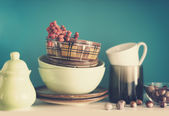 Utensils on a shelf in the kitchen, with a retro toning — Stock Photo