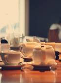 Table in cafe with cups and teapot,  image with selective focus — Stock Photo