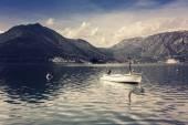 Small fishing boat in the sea bay — Stock Photo