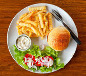 Burger with French fries on the table in a cafe — Stock Photo