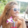 Beautiful smiling young woman  in sunglasses with a cocktail at  — Stock Photo #67288527