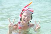 Woman with a mask for snorkeling in the sea background — ストック写真