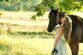 Blond rider on the horse — Stock Photo