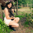 Pretty woman in flower wreath with cat — Stock Photo #52340957