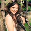 Pretty woman in flower wreath with cat — Stock Photo #52340975