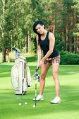 Attractive golfer girl — Stock Photo