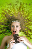 Attractive woman eating chocolate — Stock Photo