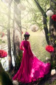 Woman in long pink dress on the nature — Stock Photo