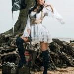 Pirate woman standing near treasure chest — Stock Photo #78213768