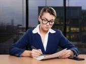 Businesswoman working in office, writing — Stock Photo