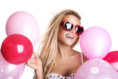 Young beautiful woman with glasses holding pink balloons, valent — Stock Photo