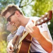 Friends with guitar having fun — Stock Photo #51843187