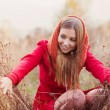 Girl in autumn nature — Stock Photo