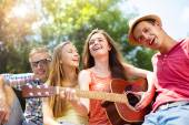 Friends with guitar having fun — Stock Photo