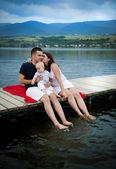 Family sitting on pier — Stock Photo
