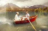 Senior couple paddling on boat — Stock Photo