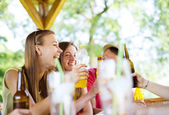 Friends drinking and having fun in pub — Stock Photo