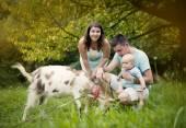 Happy family with goat — Stockfoto
