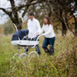 Parents with baby in vintage pram — Stock Photo #52817263